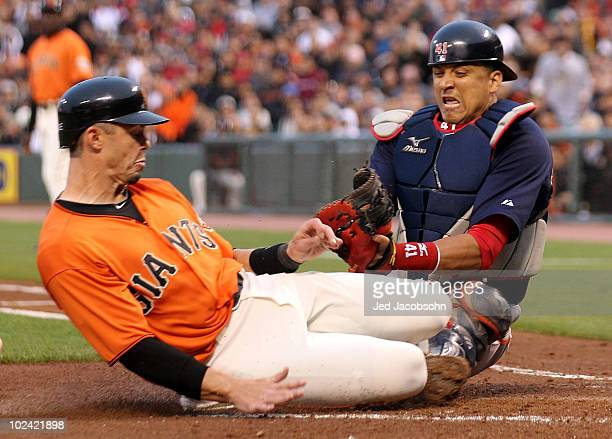 Eli Whiteside of the San Francisco Giants is tagged out at home by Victor Martinez of the Boston Red Sox on a fielders choice hit by Andres Torres in...