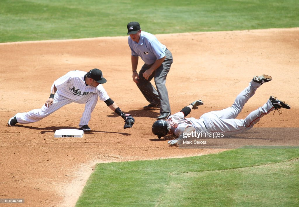 Eli Whiteside #22 of the San Francisco Giants is tagged out at second base by <a gi-track='captionPersonalityLinkClicked' href=/galleries/search?phrase=Alfredo+Amezaga&family=editorial&specificpeople=239472 ng-click='$event.stopPropagation()'>Alfredo Amezaga</a> #6 of the Florida Marlins at Sun Life Stadium on August 14, 2011 in Miami Gardens, Florida.