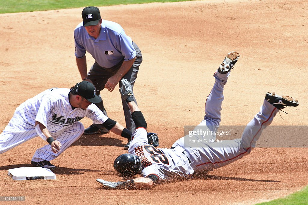 Eli Whiteside #22 of the San Francisco Giants is tagged out at second base by <a gi-track='captionPersonalityLinkClicked' href=/galleries/search?phrase=Alfredo+Amezaga&family=editorial&specificpeople=239472 ng-click='$event.stopPropagation()'>Alfredo Amezaga</a> #6 of the Florida Marlins during a MLB game at Sun Life Stadium on August 14, 2011 in Miami Gardens, Florida.