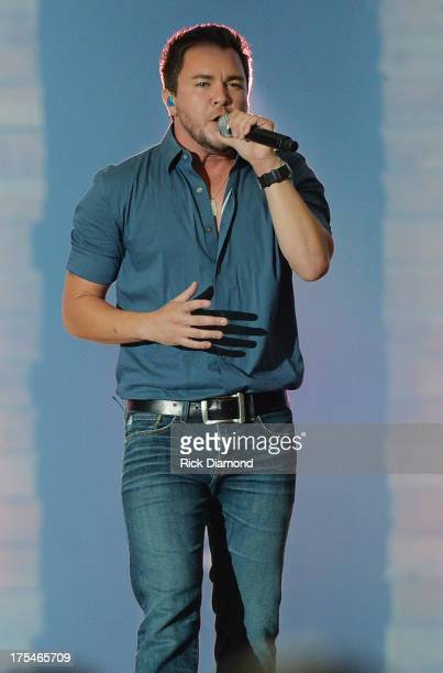 Eli Young Band member Mike Eli performs during Kenny Chesney's No Shoes Nation on Zac Brown's Southern Ground Tour at the Georgia Dome on August 3...