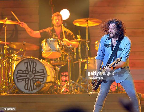 Eli Young Band members Chris Thompson and James Young perform during Kenny Chesney's No Shoes Nation on Zac Brown's Southern Ground Tour at the...