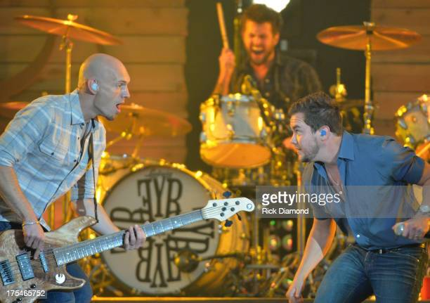 Eli Young Band members Jon Jones Chris Thompson and Mike Eli perform during Kenny Chesney's No Shoes Nation on Zac Brown's Southern Ground Tour at...
