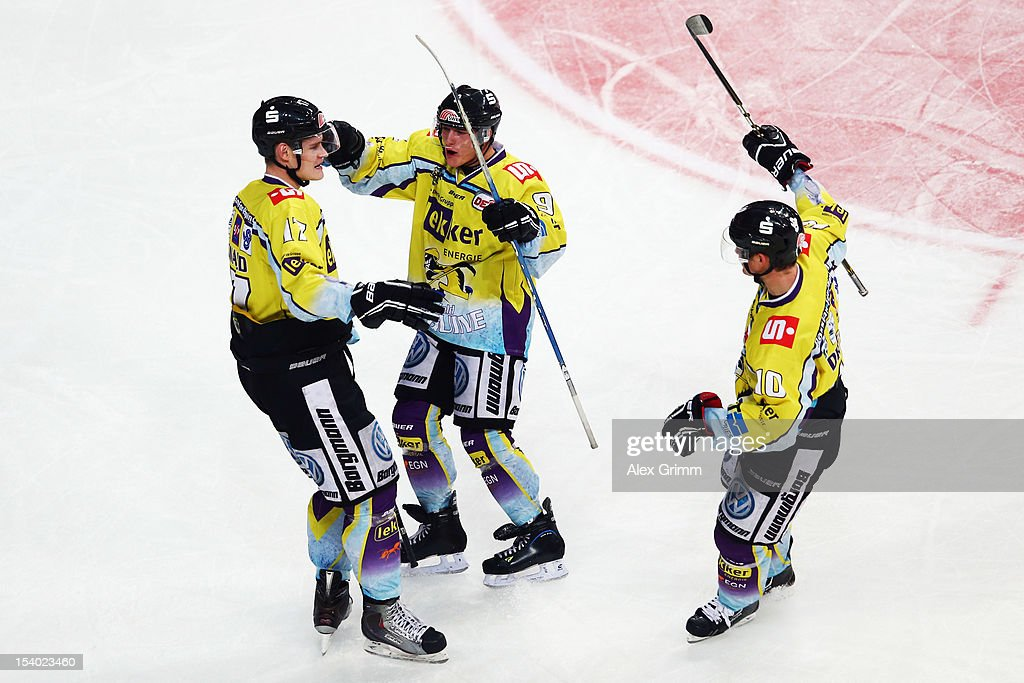Elia Ostwald of Krefeld celebrates his team's fourth goal with team mates during the DEL match between Adler Mannheim and Krefeld Pinguine at SAP-Arena on October 12, 2012 in Mannheim, Germany.