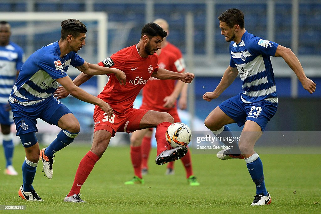 Elia Soriano (C) of Wuerzburg battles for the ball during the 2. Bundesliga playoff leg 2 match between MSV Duisburg and Wuerzburger Kickers at Schauinsland-Reisen-Arena on May 24, 2016 in Duisburg, Germany.