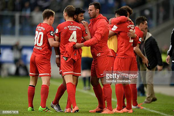 Elia Soriano of Wuerzburg celebrates with team mates after scoring his team's first goal during the 2 Bundesliga playoff leg 2 match between MSV...