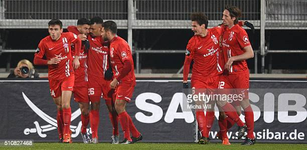Elia Soriano of Wuerzburg celebrates with teammates after scoring the opening/first goal during the Third League match between Wuerzburger Kickers...
