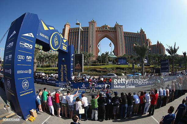 Elia Viviani of Italy and Team Sky crosses the finishing line to claim victory from Sacha Modolo of Italy and Lampre Merida in front of the Palm...