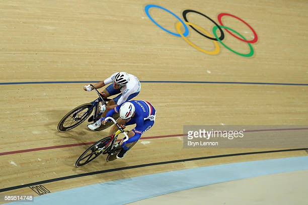 Elia Viviani of Italy and Thomas Boudat of France compete in the Elimination race on Day 9 of the Rio 2016 Olympic Games at the Rio Olympic Velodrome...
