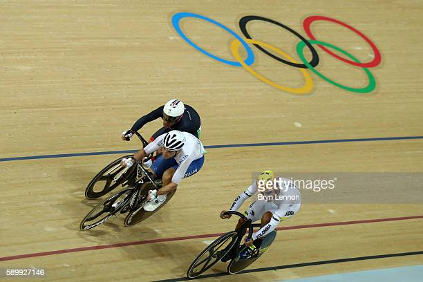 Elia Viviani of Italy competes ahead of Mark Cavendish of Great Britain and Fernando Gaviria Rendon of Colombia during the Cycling Track Men's Omnium...