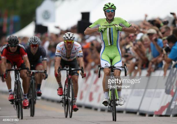Elia Viviani of Italy riding for Cannondale celebrates his victory in stage four of the 2014 USA Pro Challenge ahead of Martin Kohler of Switzerland...