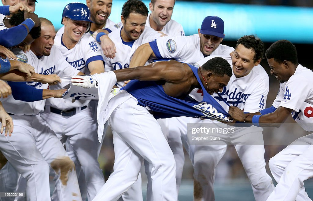 Elian Herrera #37 of the Los Angeles Dodgers has his tee shirt torn off by <a gi-track='captionPersonalityLinkClicked' href=/galleries/search?phrase=Dee+Gordon&family=editorial&specificpeople=7091343 ng-click='$event.stopPropagation()'>Dee Gordon</a> #9 as Herrera is mobbed by teammates after his walk off RBI single in the ninth inning to defeat the San Francisco Giants on October 1, 2012 at Dodger Stadium in Los Angeles, California. The Dodgers won 3-2.