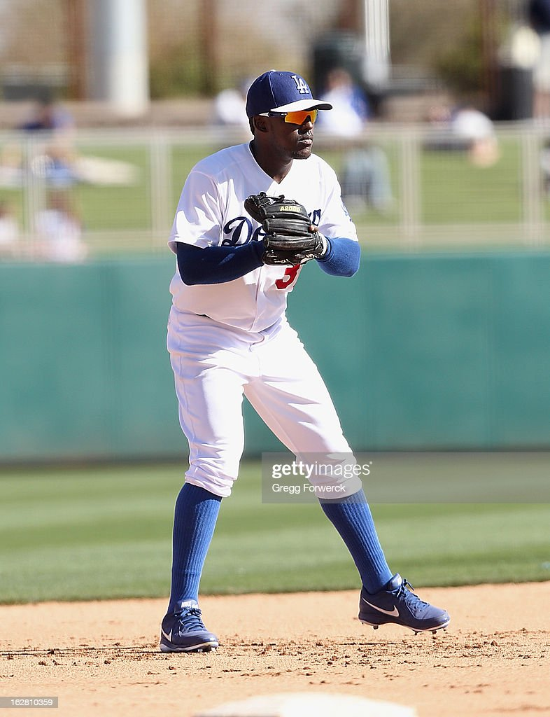 Elian Herrera of the Los Angeles Dodgers plays third base during a spring training baseball game against the San Francisco Giants at Camelback Ranch on February 26, 2013 in Glendale, Arizona.