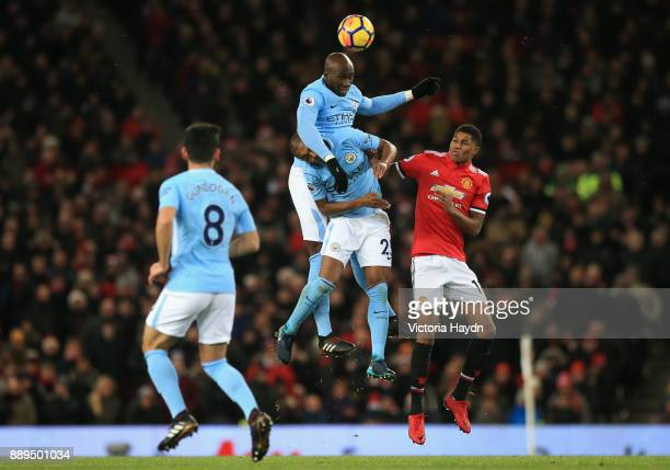 Eliaquim Mangala and Fernandinho of Manchester City clash with Marcus Rashford of Manchester United during the Premier League match between...