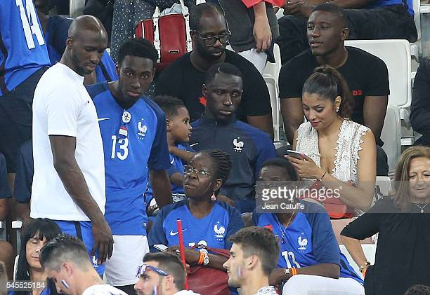 Eliaquim Mangala and Moussa Sissoko of France with their families celebrate the victory following the UEFA Euro 2016 semifinal match between Germany...
