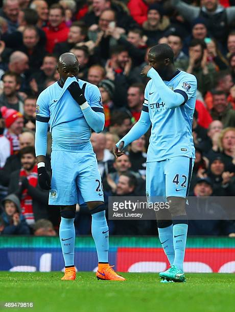 Eliaquim Mangala and Yaya Toure of Manchester City look dejected during the Barclays Premier League match between Manchester United and Manchester...