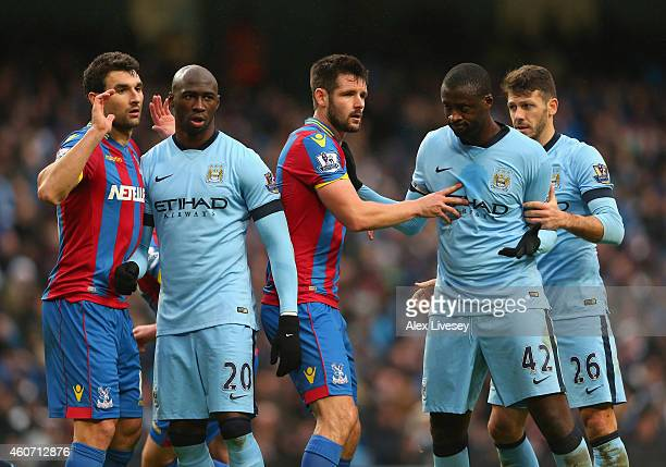 Eliaquim Mangala and Yaya Toure of Manchester City look for space against Scott Dann and Mile Jedinak of Crystal Palace during a corner kick in the...