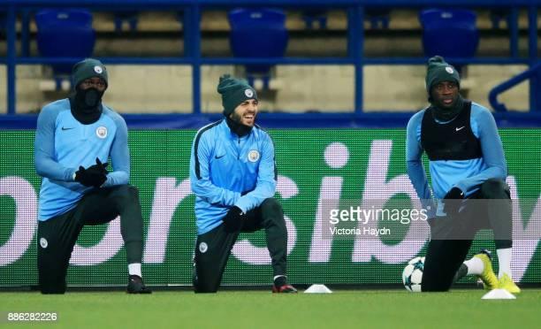 Eliaquim Mangala Bernardo Silva and Yaya Toure joke during a Manchester City training session on December 5 2017 in Kharkov Ukraine