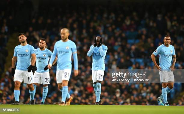 Eliaquim Mangala of Manchester City alongside team mates looks on during the Premier League match between Manchester City and West Ham United at...