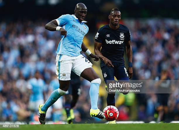 Eliaquim Mangala of Manchester City and Diafra Sakho of West Ham United compete for the ball during the Barclays Premier League match between...