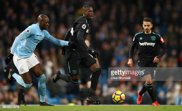 Eliaquim Mangala of Manchester City and Pedro Obiang of West Ham United battle for possession during the Premier League match between Manchester City...