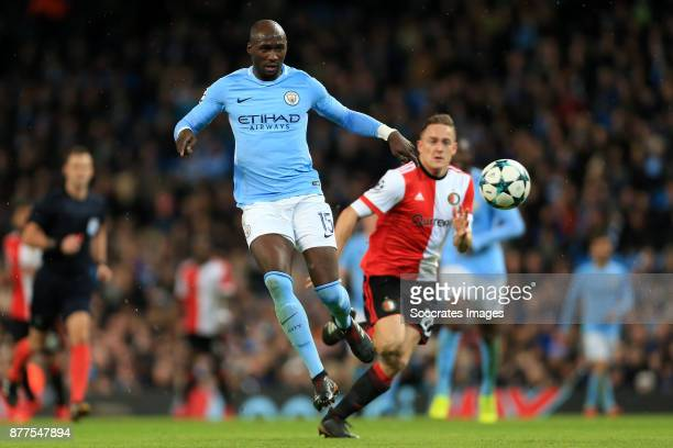 Eliaquim Mangala of Manchester City battles with Jens Toornstra of Feyenoord during the UEFA Champions League match between Manchester City v...