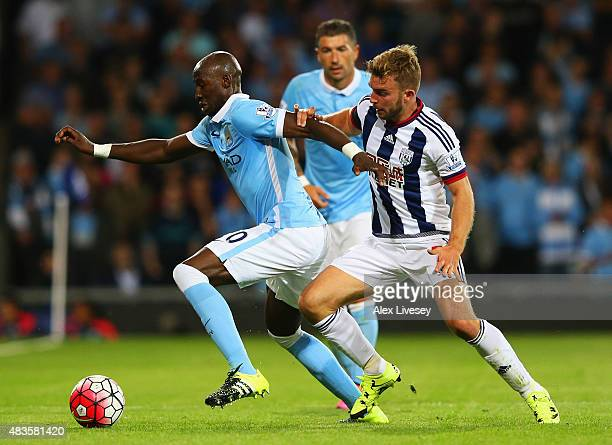 Eliaquim Mangala of Manchester City evades James Morrison of West Bromwich Albion during the Barclays Premier League match between West Bromwich...