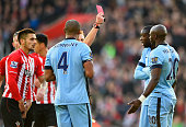Eliaquim Mangala of Manchester City is shown a red card by referee Mike Jones and is sent off during the Barclays Premier League match between...
