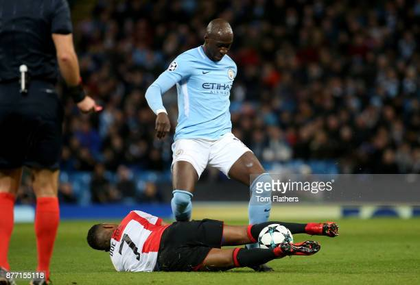 Eliaquim Mangala of Manchester City is tackled by JeanPaul Boetius of Feyenoord during the UEFA Champions League group F match between Manchester...