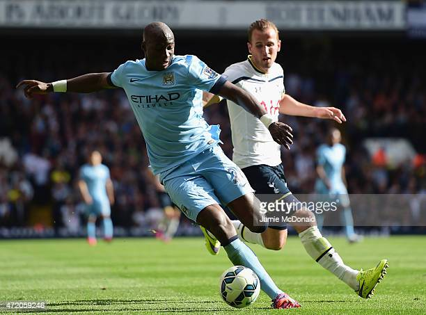 Eliaquim Mangala of Manchester City shields the ball from Harry Kane of Spurs during the Barclays Premier League match between Tottenham Hotspur and...
