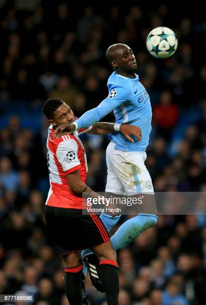 Eliaquim Mangala of Manchester City wins a header infront of JeanPaul Boetius of Feyenoord during the UEFA Champions League group F match between...