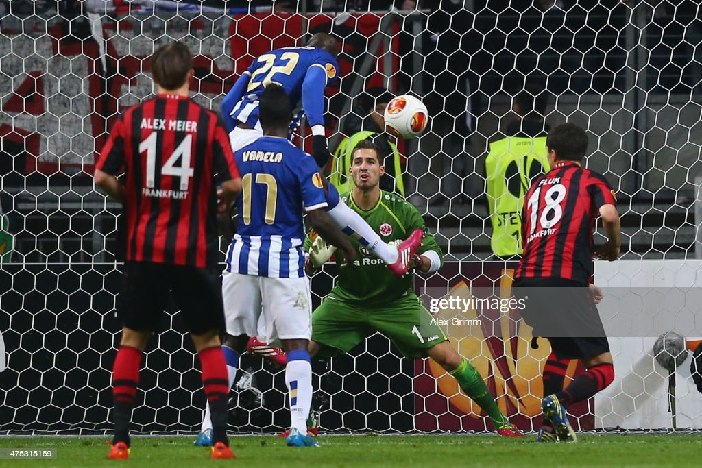 <a gi-track='captionPersonalityLinkClicked' href=/galleries/search?phrase=Eliaquim+Mangala&family=editorial&specificpeople=5713850 ng-click='$event.stopPropagation()'>Eliaquim Mangala</a> of Porto scores his team's second goal against goalkeeper <a gi-track='captionPersonalityLinkClicked' href=/galleries/search?phrase=Kevin+Trapp&family=editorial&specificpeople=4409868 ng-click='$event.stopPropagation()'>Kevin Trapp</a> of Frankfurt during the UEFA Europa League Round of 32 second leg match between Eintracht Frankfurt and FC Porto at Commerzbank Arena on February 27, 2014 in Frankfurt am Main, Germany.