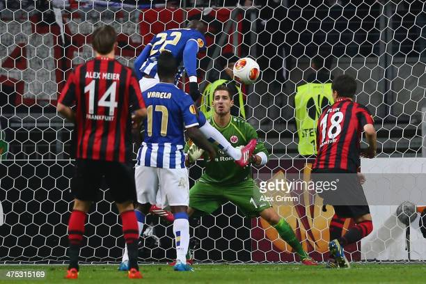 Eliaquim Mangala of Porto scores his team's second goal against goalkeeper Kevin Trapp of Frankfurt during the UEFA Europa League Round of 32 second...