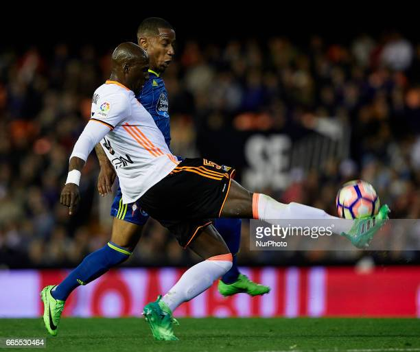 Eliaquim Mangala of Valencia CF competes for the ball with Claudio Beauvue of Real Club Celta de Vigo during the La Liga match between Valencia CF...