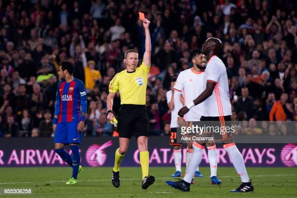 Eliaquim Mangala of Valencia CF is shown a red card during the La Liga match between FC Barcelona and Valencia CF at Camp Nou stadium on March 19...