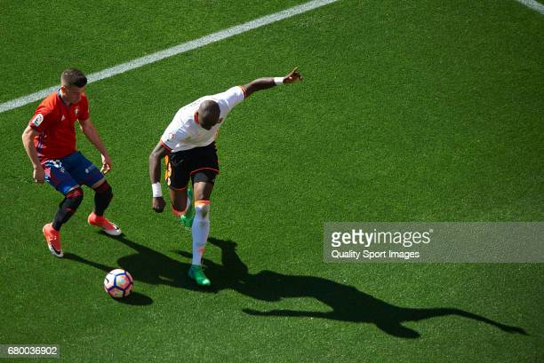 Eliaquim Mangala of Valencia competes for the ball with Alex Berenguer of Osasuna during the La Liga match between Valencia CF and CA Osasuna at...