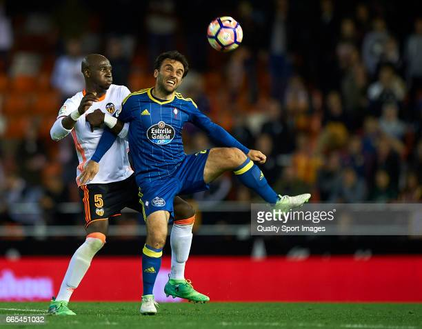 Eliaquim Mangala of Valencia competes for the ball with Giuseppe Rossi of Celta de Vigo during the La Liga match between Valencia CF and RC Celta de...