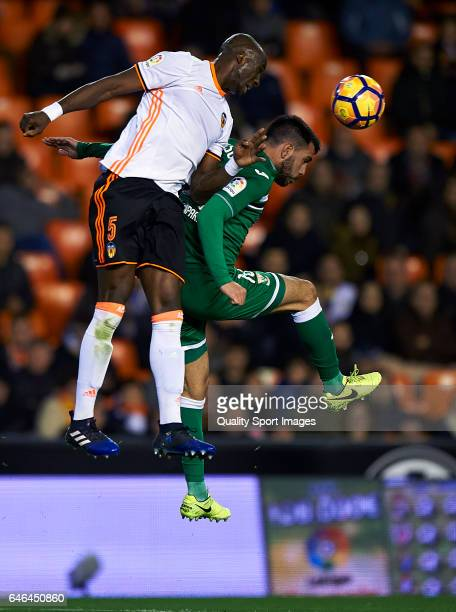 Eliaquim Mangala of Valencia competes for the ball with Pablo Insua Blanco of Leganes during the La Liga match between Valencia CF and CD Leganes at...