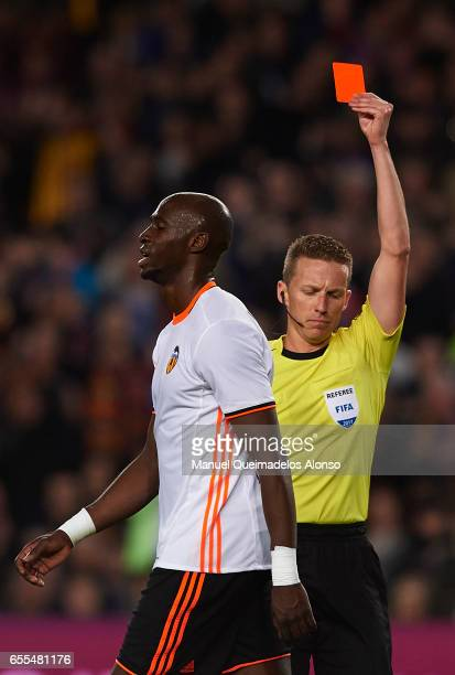 Eliaquim Mangala of Valencia is shown a red card and sent off by referee Alejandro Hernandez Hernandez during the La Liga match between FC Barcelona...