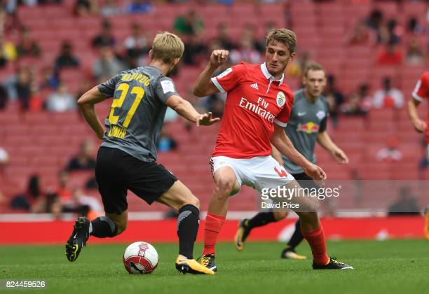 Elias Abouchabaka of Benfica challenges Rafa of RB Leipzig during the match between RB Leipzig v SL Benfica at Emirates Stadium on July 30 2017 in...