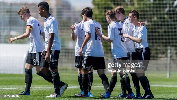 Elias Abouchabaka of Germany and Kilian Ludewig of Germany celebrate a goal during the UEFA U17 elite round match between Germany and Finland on...