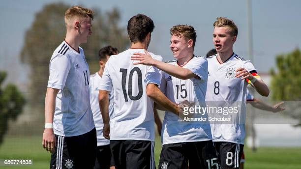Elias Abouchabaka of Germany celebrates the fourth goal of his team during the UEFA U17 elite round match between Germany and Armenia on March 23...