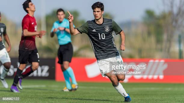 Elias Abouchabaka of Germany celebrates the third goal for his team with his teammates during the UEFA U17 elite round match between Germany and...