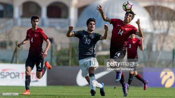 Elias Abouchabaka of Germany challenges Berkehan Bicer of Turkey during the UEFA U17 elite round match between Germany and Turkey on March 28 2017 in...