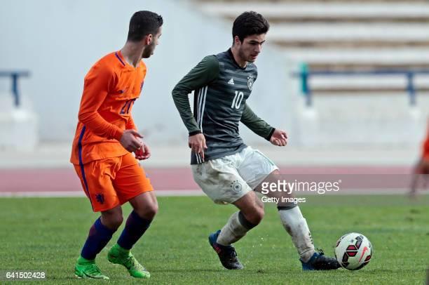 Elias Abouchabaka of Germany U17 challenges Achraf el Bouchatoui of Netherlands U17 during the 40º Algarve International Tournament U17 Match between...