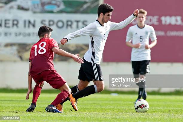 Elias Abouchabaka of Germany U17 challenges Andre Almeida of Portugal U17 during the U17 Algarve Cup Tournament Match between Portugal U17 and...