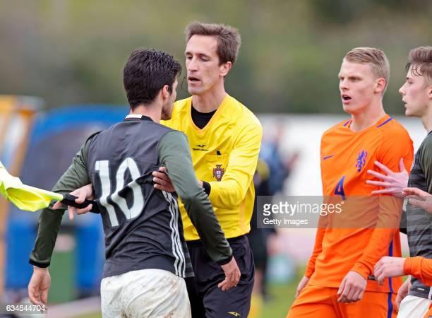 Elias Abouchabaka of Germany U17 challenges Mitchel Bakker of Netherlands U17 after a fault soffered during the Algarve International Tournament U17...