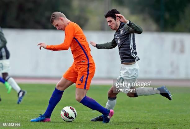 Elias Abouchabaka of Germany U17 challenges Mitchel Bakker of Netherlands U17 during the Algarve International Tournament U17 Match between...