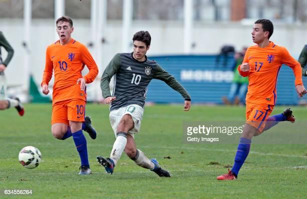 Elias Abouchabaka of Germany U17 challenges Orkun Kokcu and Daniel van Kaam of Netherlands U17 during the Algarve International Tournament U17 Match...