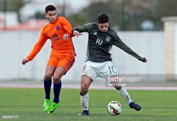 Elias Abouchabaka of Germany U17 challenges Zakaria Aboukhlal of Netherlands U17 during the Algarve International Tournament U17 Match between...