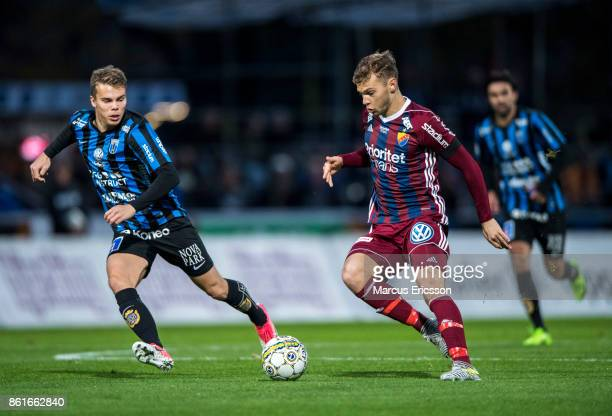 Elias Andersson of IK Sirius FK and Jesper Karlstrom of Djurgardens IF during the Allsvenskan match between IK Sirius and Djurgardens IF at...